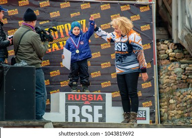 SERPUKHOV, RUSSIA - OCTOBER 7, 2017: champion Boris Volostnykh (24), ATV Class-JUNIORS, in the stage 4 MX series, the Red Wings Cup 2017 super country-cross, Moto-track Island Drakino