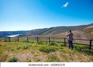 Serra da Estrela Natural Park. Man takes a photo. Portugal, Europe