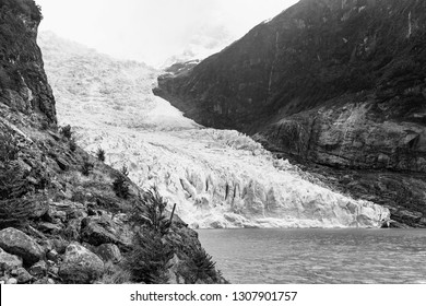 The Serrano glacier inside Bernardo O'Higgins national park in black and white, Patagonia, Chile. The Serrano glacier is in the list of the receding glaciers of Patagonia due to climate change.