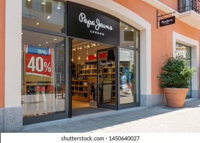 """Serravalle, Italy 07.14.2019 Fashion designer outlet summer sales. The entrance view of the """"Pepe Jeans"""" store"""