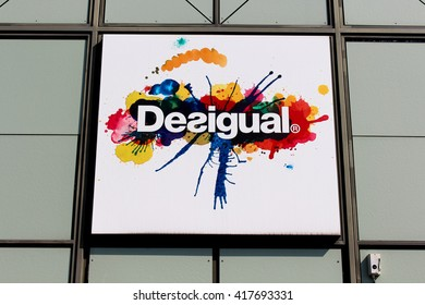 SERRIS, FRANCE - MAY 8, 2016: Desigual sign. Desigual is a Spanish company of design, manufacture and distribution of clothing ready-to-wear created in 1984.
