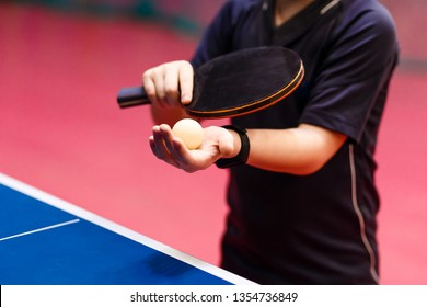 serve the ball in table tennis close, fitness bracelet on the hand
