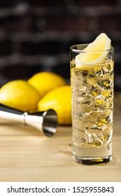 Serve whiskey highball with lemon on the bar counter