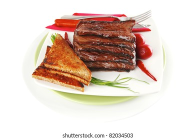 served beef with dishware on white dish