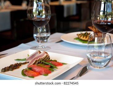 Served dinner with seafood and vine