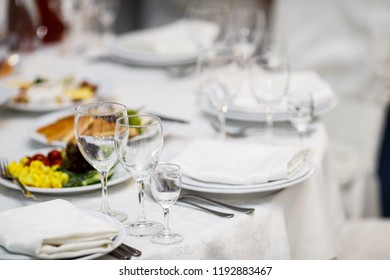 Served dishes to the table for holiday. Delicious dishes on the table in the restaurant. serving table.