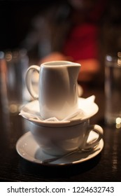 served espresso  coffee with hot water for caffe americano closeup on table in cafe
