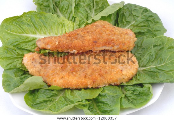 Served fresh roast pork meat on green salad , delicious dinner isolated on white background image