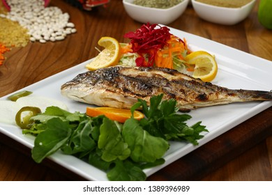 Served grill fish with vegetable on plate