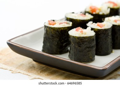 Served makizushi made from mozzarella and tomatoes as example for crossover kitchen.