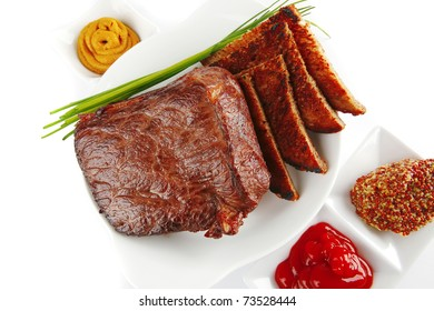 served meat with spices and toasted bread