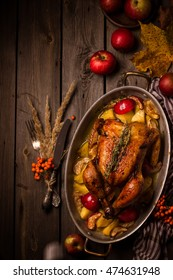 Served roasted stuffed Thanksgiving Turkey and vegetables from above and blank space. Fall decoration.Style rustic.