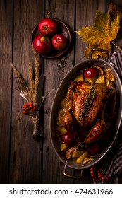 Served roasted stuffed Thanksgiving Turkey and vegetables from above and blank space. Style rustic.