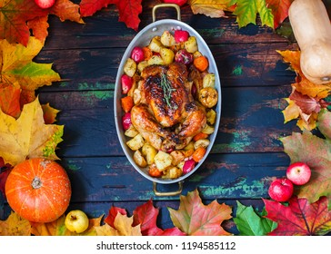 Served roasted Thanksgiving Turkey in autumn leaves frame, brown wooden background.Place for text.