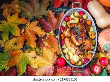 Served roasted Thanksgiving Turkey on bright autumn leaves background.Place for text.