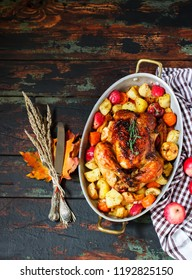 Served roasted Thanksgiving Turkey with vegetables on wooden rustic background.Place for text.