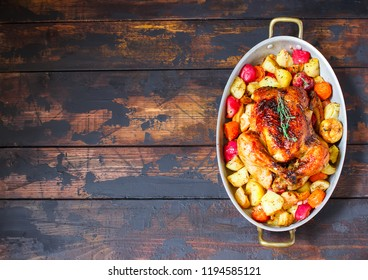 Served roasted Thanksgiving Turkey with vegetables on brown wooden rustic background.Place for text.