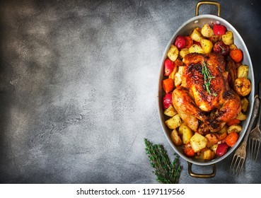 Served roasted Thanksgiving Turkey with vegetables on grey stone background.Place for text.