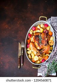 Served roasted Thanksgiving Turkey with vegetables on brown rustic background.Place for text.