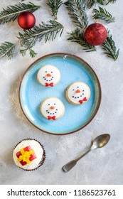 Served snowman cookies in the plate,selective focus