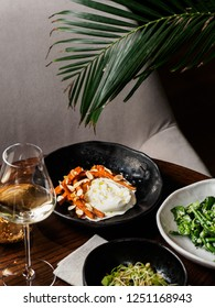 Served table with healthy dishes and white wine