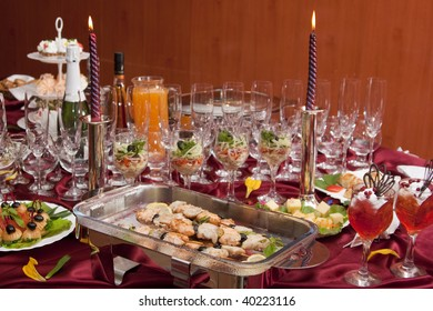 The served table with red wine at restaurant. Shish kebab on a dish.
