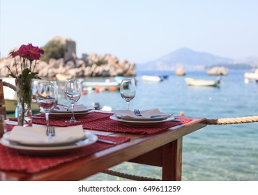 Served table in restaurant on sea background