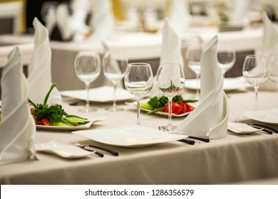 served table with white napkins in a beautiful interior