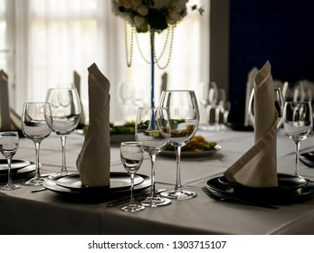 Served tables in restaurant for wedding reception