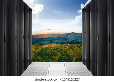 Server Computer Rack in Data Center isolated on mountain background.