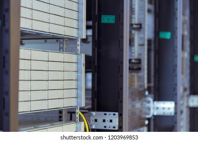 Servers in storage cabinets in data center and  Powerful database servers