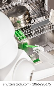 service autonomous household robot is putting dish in the dishwasher