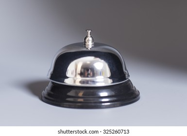 Service bell on gray background