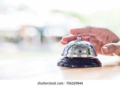 Service Bell. Person using their finger to ring a counter bell.�