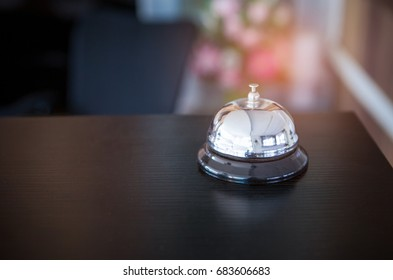 A service bell at reception desk in a hotel