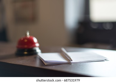 A service bell at reception desk in a hotel. Blurred.