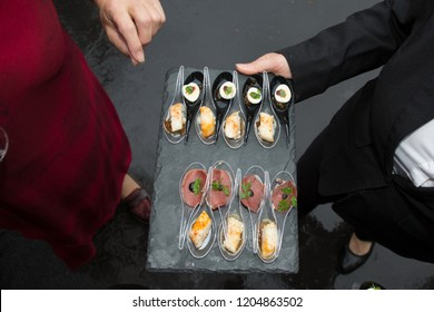 service by the waiter of petit fours appetizers