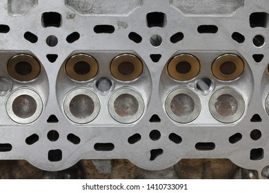 Service of car engine cylinder head, four valve construction