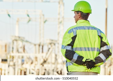Service engineer standing in front of electro power plant