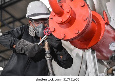 Service engineer working at industrial