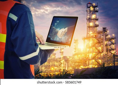 Service engineer working with laptop in Oil Refinery