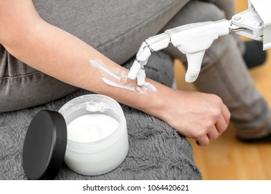 service nursing robot is putting some lotion on the arm of a woman