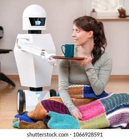 service robot is giving a brunette, pretty woman a coffee in the living room, display of the household robot is showing a coffee break symbol