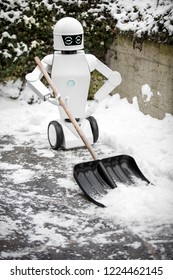 service robot is shovelling snow in the winter, portrait of the autonomous robot while standing in the snow