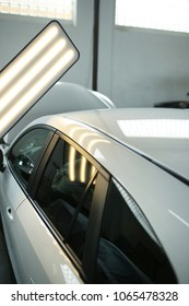 service station, hail damage, lights for detecting dents in a car body