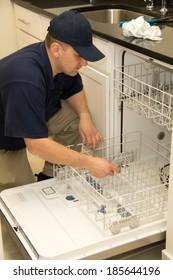 Service technician fixing dishwasher