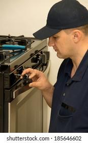 Service technician repairs stove