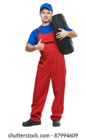 serviceman repairman automobile mechanic with car tire isolated