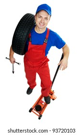 serviceman repairman automobile mechanic with car tire and lifting jack isolated