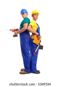 Serviceman and servicewoman wearing yellow and blue helmet and blue overall standing back to back - man holding driller, woman holding black toolbox - isolated on white background